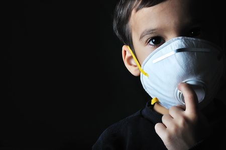Little child with a mask on his face