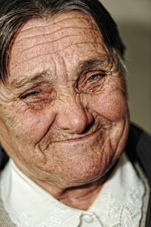 Closeup portrait of elderly happy woman smiling, age between 60 and 70