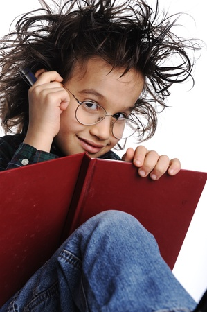 Smart nerd kid with glasses and funny hair writing