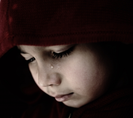 Sad child crying