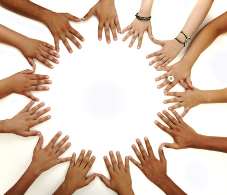 Photo pour Conceptual symbol of multiracial children  hands making a circle on white background with a copy space in the middle - image libre de droit