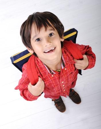 Foto de School boy with backpack - Imagen libre de derechos