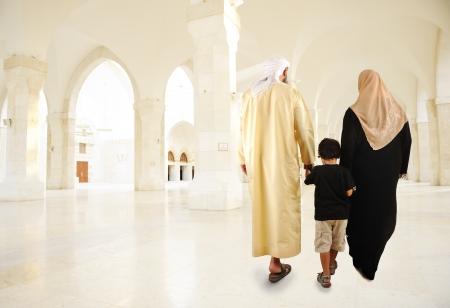 Arabic Muslim family walking indoor