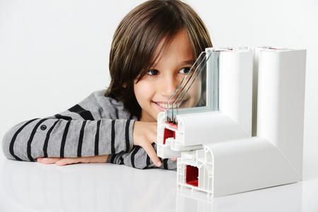 Kid holding plastic window profile