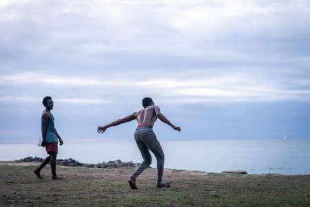 Foto für Young men exercising martial arts on the beach - Lizenzfreies Bild