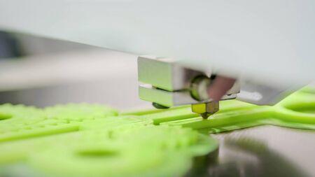 Photo pour 3D printer prints physical 3D model with plastic wire filament at modern technology exhibition. Additive technologies, science and futuristic concept - image libre de droit