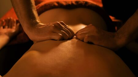 Photo pour Professional male masseur doing back massage for female client in spa center, studio. Wellness, harmony, relaxation and healthcare concept - image libre de droit