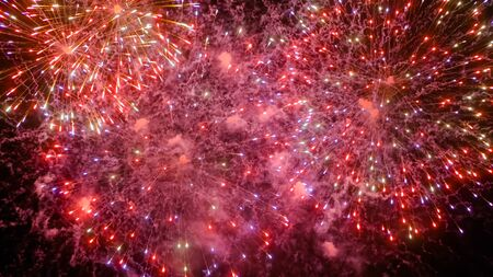 Foto per Christmas, holiday, pyrotechnical, celebration and anniversary concept. Colorful bright fireworks in dark sky at night. Evening time, low light illumination - Immagine Royalty Free