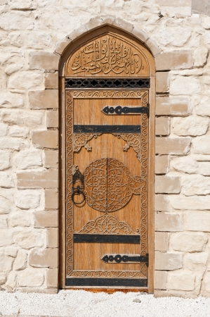 door with Arabic script in the stone wall