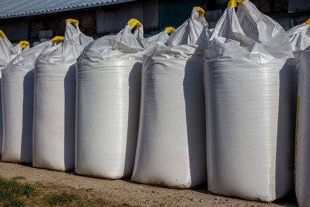Many big white bags in a row