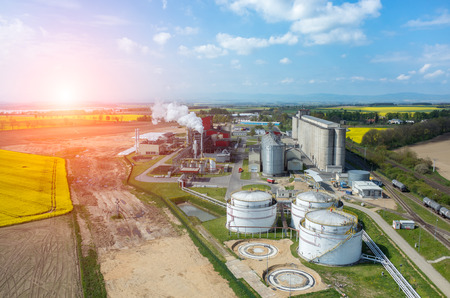 Photo for Beautiful sunset over the modern biofuel factory - Royalty Free Image