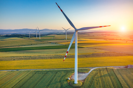 Photo for Beautiful sunset above the windmills on the field - Royalty Free Image