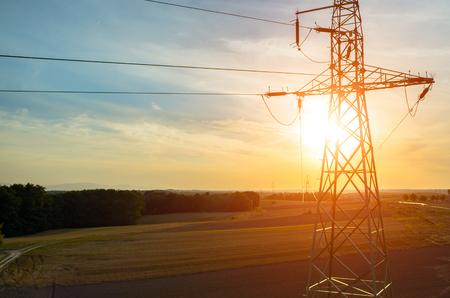 Photo for Beautiful sunset over the powerlines on the field - Royalty Free Image
