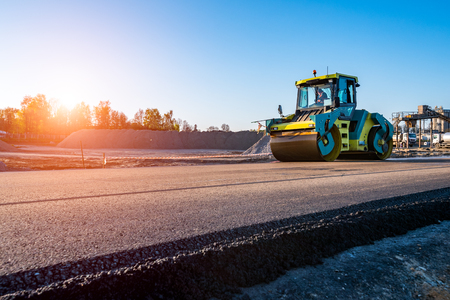 Photo for Beautiful sunset above the road rollers working on the new road construction site - Royalty Free Image