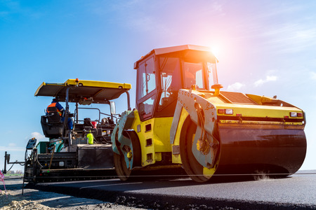Photo for Beautiful sunset above the road roller working on the new road construction site - Royalty Free Image