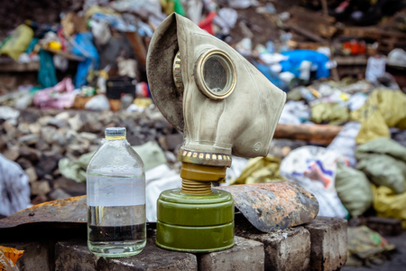 Respirator mask for gas on the background of trash.