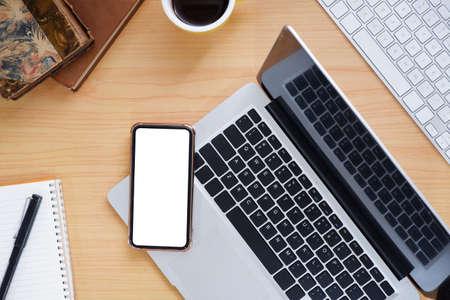 Photo pour Office wooden desk with laptop and smartphone copy space. - image libre de droit