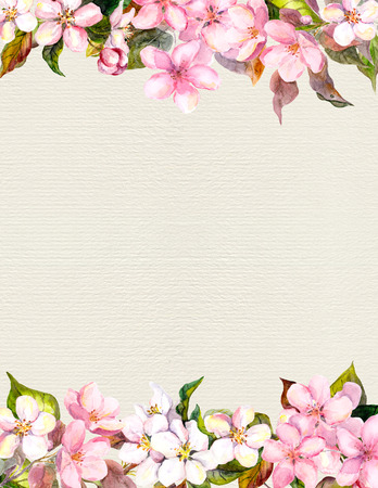 Pink flowers - apple, cherry blossom. Floral frame for romantic background. Watercolour on paper