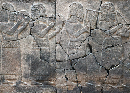 ISTANBUL, TURKEY - OCTOBER 30, 2015: Ancient stone bas-relief with musicians, late Hittite period (Aramaean, 8th Cent. B.C.) in Istanbul Archaeological Museum, Turkey