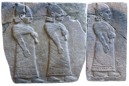 ISTANBUL, TURKEY - OCTOBER 30, 2015: Procession of palace officials - ancient stone bas-relief of late Hittite period (8th Cent. B.C.) from Samal (Sinjerli) in the Istanbul Archaeology Museum in Istanbul, Turkey
