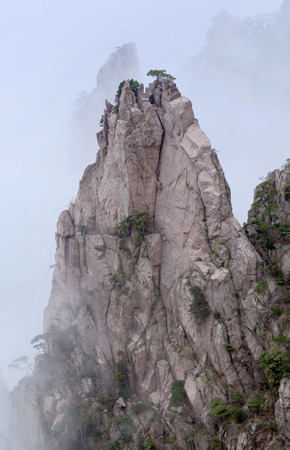 Lone rock over mist in Huangshan Mountain (Yellow Mountain), China. Of all the notable mountains in China, it is probably the most famous to be found in the south of Anhui province.