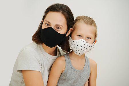 Foto de portrait of mother and son in protective masks against a white background - Imagen libre de derechos