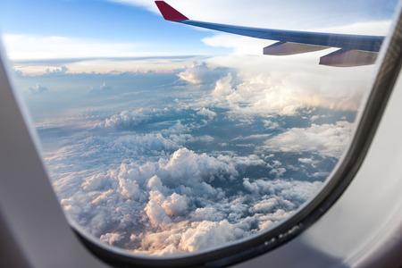 Foto de Clouds and sky as seen through window of an aircraft at sunset - Imagen libre de derechos