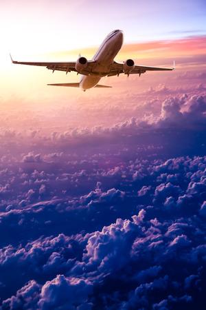 Photo pour Airplane in the sky at sunrise - image libre de droit