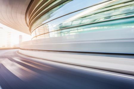 Photo pour Car driving on road in city background, motion blur - image libre de droit