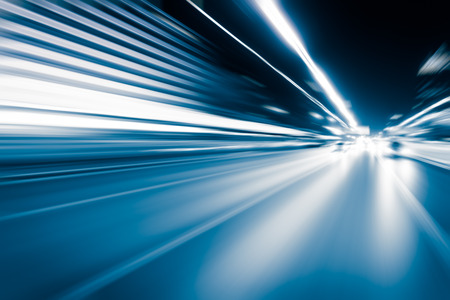 Photo pour Blue color tunnel car driving motion blur - image libre de droit