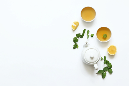 Foto für Herbal tea from mint and other herbs on a white background. T - Lizenzfreies Bild