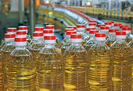 Photo for Sunflower oil in the bottle moving on production line - Royalty Free Image