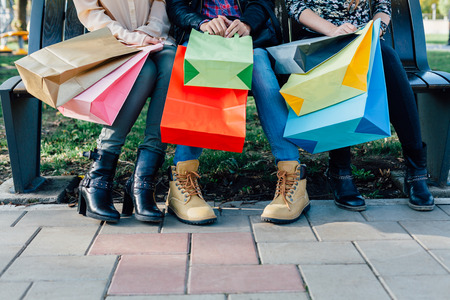 Foto de Closeup of girls with colorful shopping bags - Imagen libre de derechos