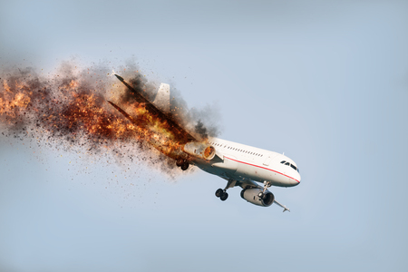 Foto de flying aircraft with exploding aero engine just before air crash - Imagen libre de derechos