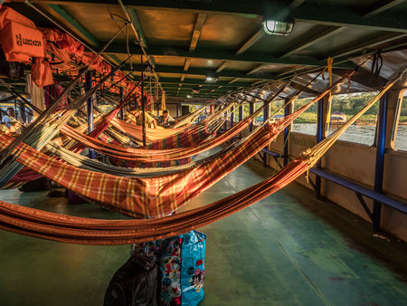 Photo for Amazon River, Peru - March 25, 2018: Beautiful, colorful hammocks on the cargo boat - Royalty Free Image