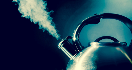 Kettle whistling, boiling kettle, steam, isolated on a black background