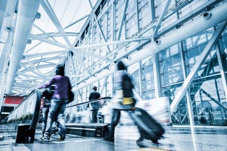 Futuristic guangzhou Airport interiorpeople walking in motion blur