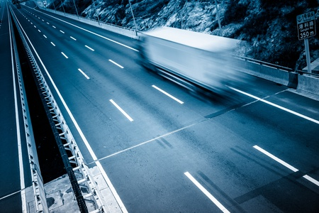 Photo for motion trucks on the freeway. - Royalty Free Image