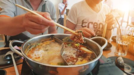 Foto de Asian family Celebrate special occasions By eating hot pot together. - Imagen libre de derechos