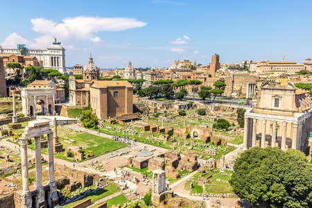 Foto per Roman Forum: ruins of the Temple of Caesar, the Temple of Antoninus and Faustina, the Temple of Vesta, the Temple of Castor and Pollux, - Immagine Royalty Free