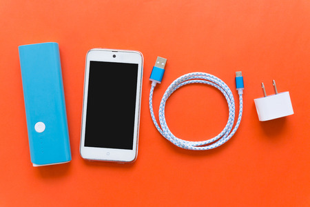 Photo pour USB charging cables for smartphone and tablet in top view - image libre de droit