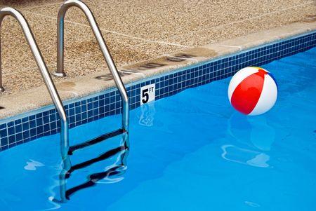 Colorful beach ball in swimming pool.