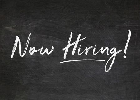 Photo for now hiring sign on dusty black chalkboard - Royalty Free Image