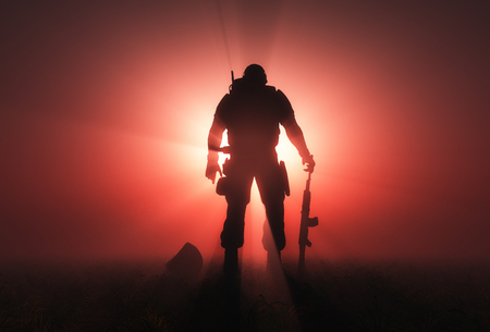 Foto de Silhouette of a soldier on a red background. - Imagen libre de derechos
