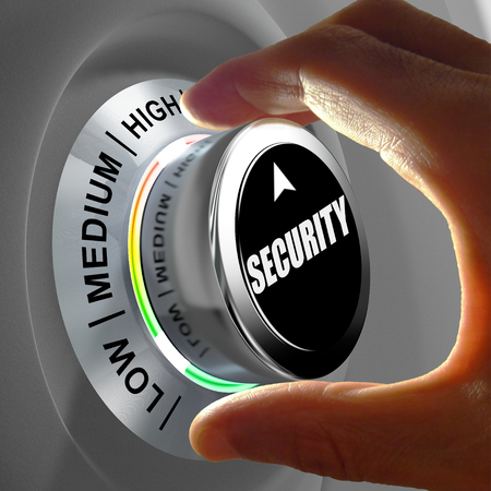 Foto de Hand rotating a button and selecting the level of security. This concept illustration is a metaphor for choosing the level of security. Three levels are available: low, medium and high. - Imagen libre de derechos