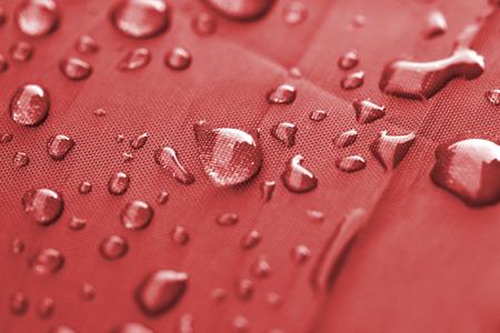 Closeup of rain drops on a water-repellent material