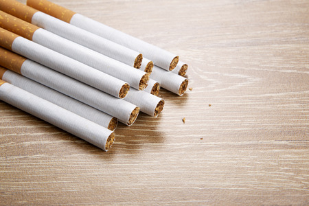 Photo for Several cigarettes on a wooden background - Royalty Free Image