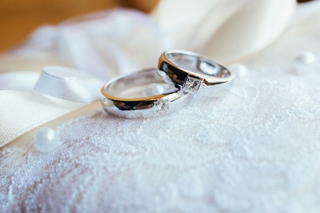 Photo for Beautifull wedding rings on white lace pillow - Royalty Free Image