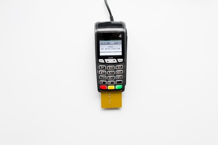 Photo for payment terminal with card on white background top view. - Royalty Free Image