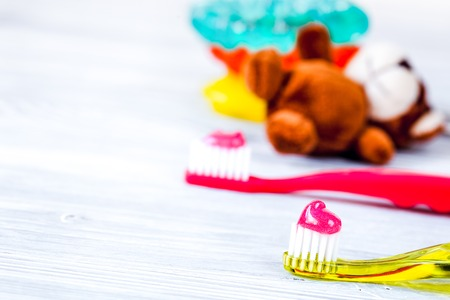 Photo for children's toothbrush oral care on wooden background. - Royalty Free Image